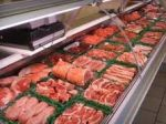Fresh meat shown in grocery display